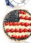 Baked sweet fruit pie with American flag design,selective focus and 4th of July concept